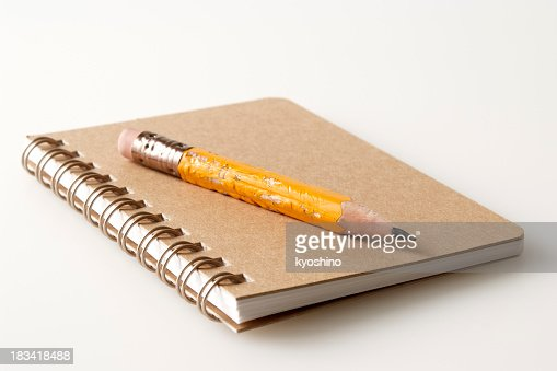 Isolated shot of brown spiral notebook on white background