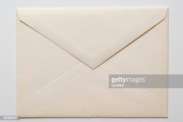 Isolated shot of closed an old envelope on white background