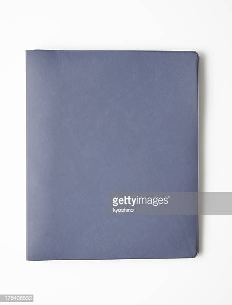Isolated shot of closed blank ring binder on white background