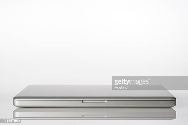 Isolated shot of closed laptop on white background