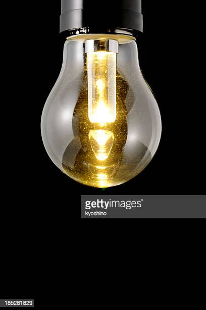Isolated shot of illuminated LED light bulb against black background