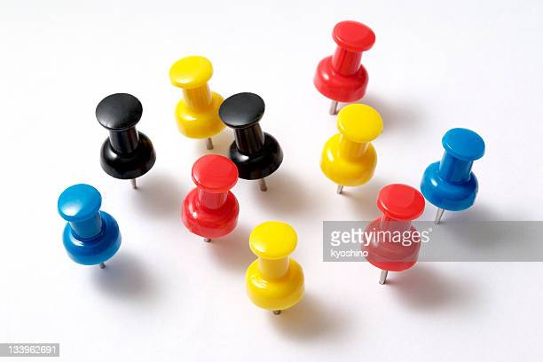 Isolated shot of multicolored thumbtack on white background