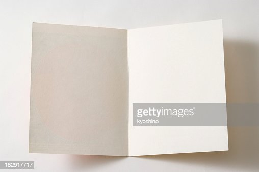 Isolated shot of opened antique blank paper on white background