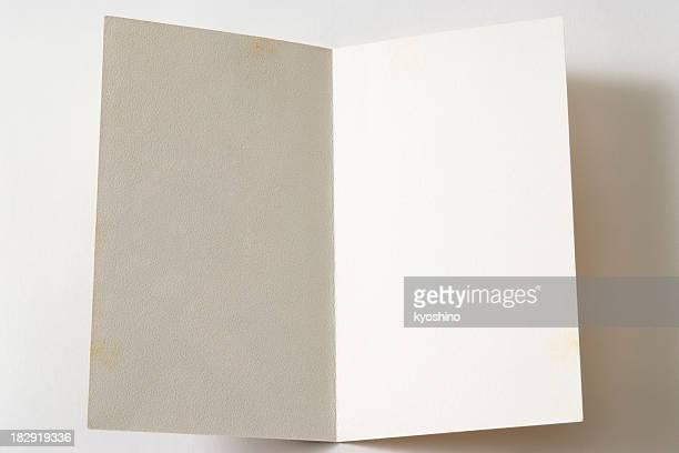 Eröffnete alte leere Papier auf weißem Hintergrund mit Schatten