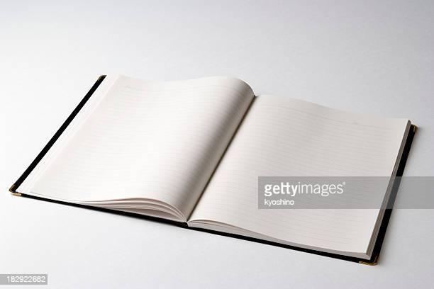 Isolated shot of opened blank notebook on white background