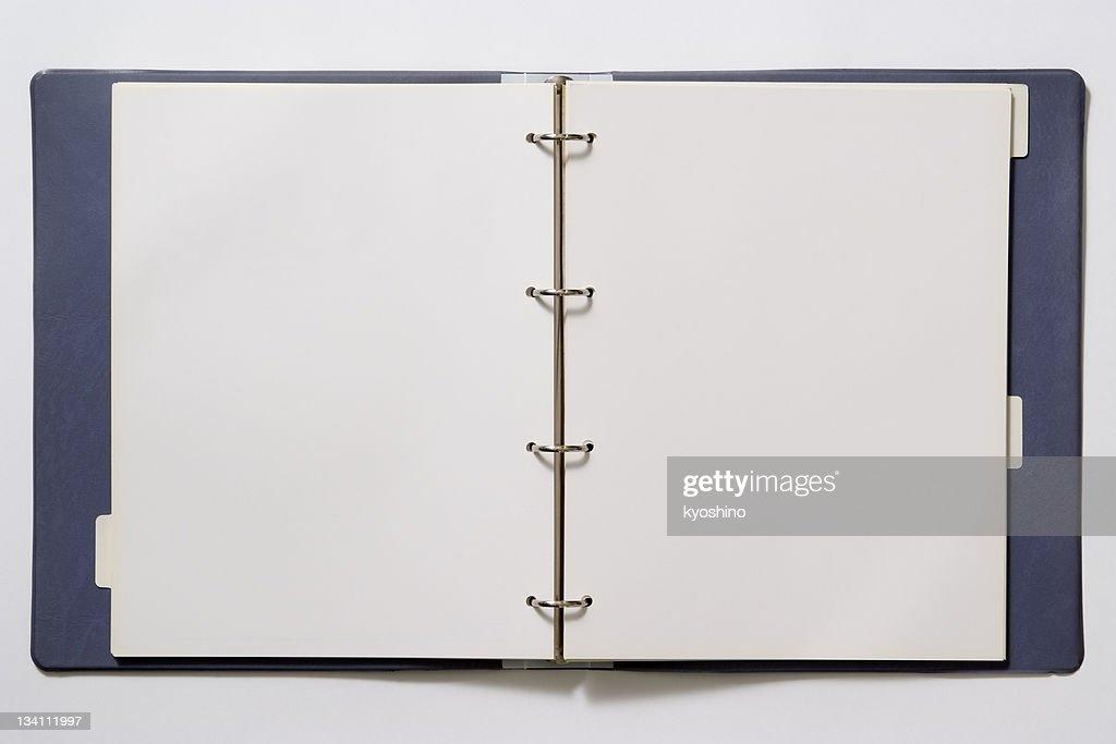Isolated shot of opened blank ring binder on white background