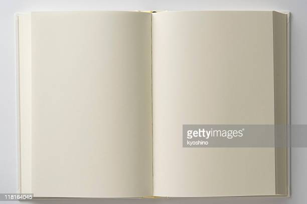 Isolated shot of opened blank white book on white backgrounds