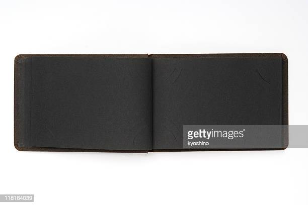 Isolated shot of opened vintage card album on white background
