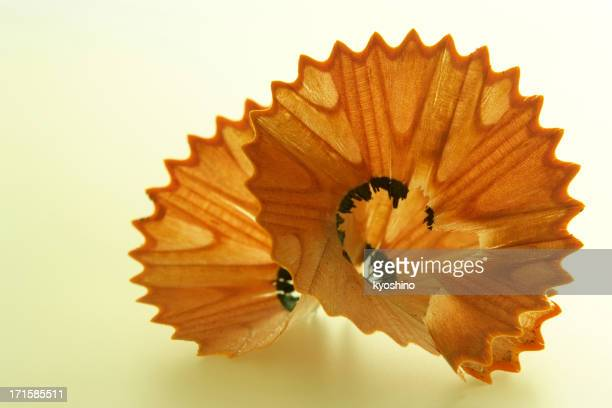 Isolated shot of pencil shavings on yellow background
