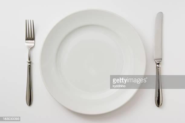 絶縁ショットの皿、食卓用金物を白背景