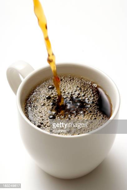 Isolated shot of pouring a fresh coffee on white background