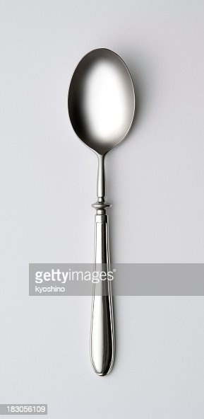 Isolated shot of shiny silver spoon on white background