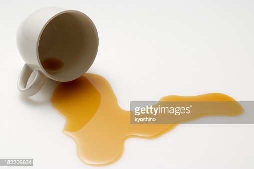 Isolated shot of spilled coffee on white background