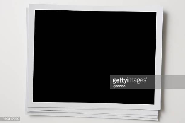 Isolated shot of stacked blank photo frames on white background