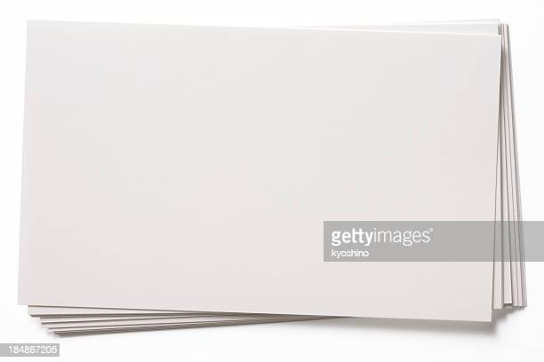 Isolated shot of stacked blank white cards on white background