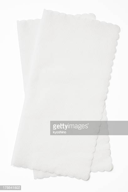 Isolated shot of stacked white paper napkins on white background