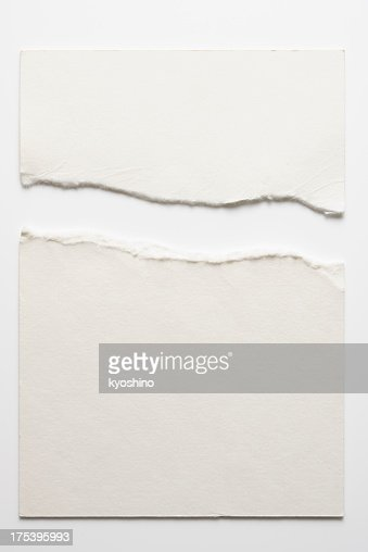 Isolated shot of torn blank white paper on white background