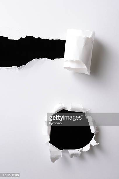 Isolated shot of two different holes on black background
