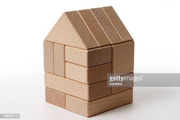 Isolated shot of wood block house on white background
