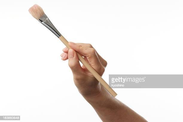 Isolierte Schuss von der Maler hand auf weißem Hintergrund