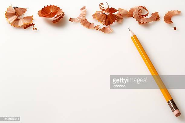 Isolated shot of yellow pencil and shavings on white background