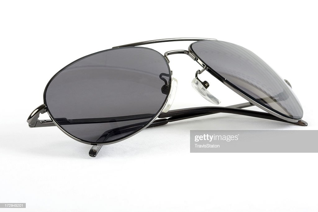 Isolated sunglasses with folded earpieces