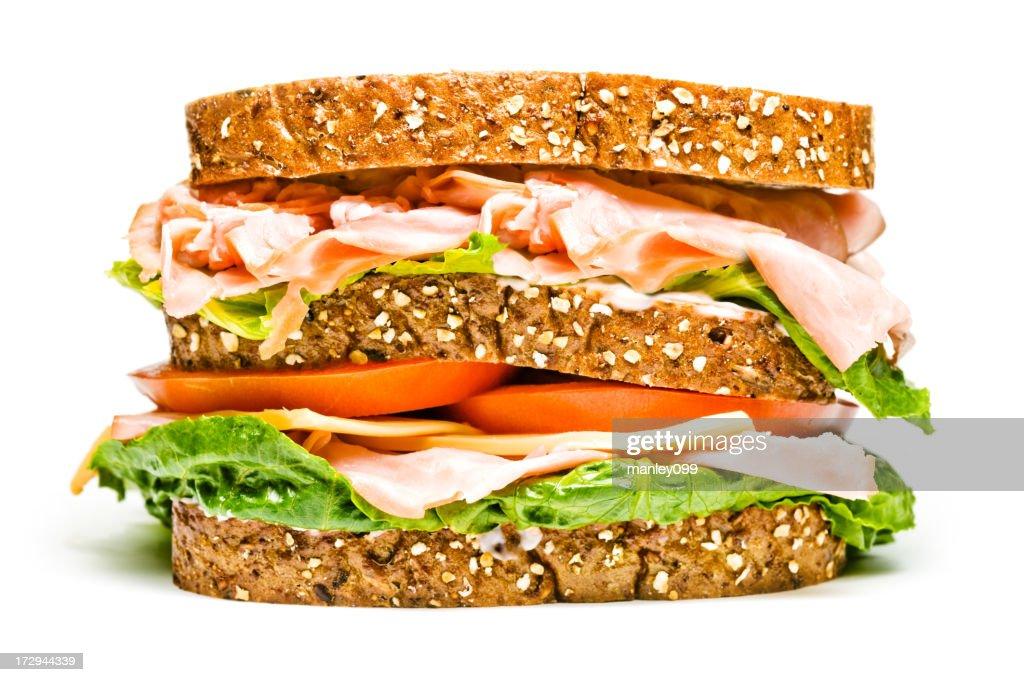 isolated turkey and ham sandwich