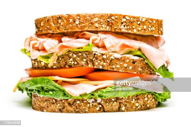 isolated turkey and ham sandwich