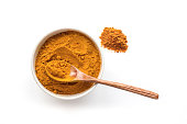 Golden turmeric powder. Concrete background. Traditional indian spice.