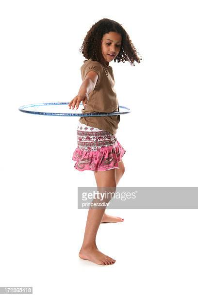 Isolated tween girl hula hooping on white background