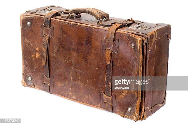 Isolated vintage old suitcase isolated on white