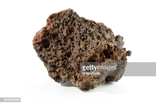 Isolated volcanic basalt lava with bubbles rock on white