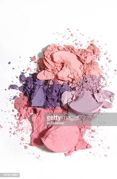 Isolated warm-toned makeup crushed into pieces