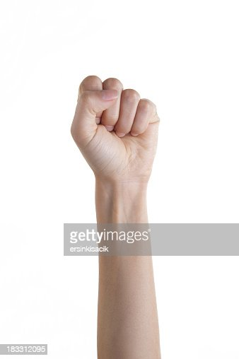 Isolated woman's fist punching upward