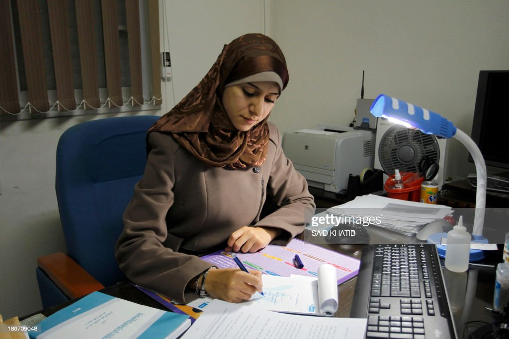 Isra Almodallal, the first woman to be nominated as spokeswoman for Gaza's Islamist rulers Hamas, sits at her desk at her home in the town of Rafah, in the southern Gaza Strip, on November 3, 2013. Almodallal, a 23-year-old journalist, told AFP last week her goal was 'to change the image of Palestinians and that of the government in Gaza,'.