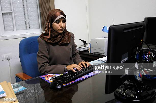 Isra Almodallal the first woman to be nominated as spokeswoman for Gaza's Islamist rulers Hamas sits at her desk at her home in the town of Rafah in...