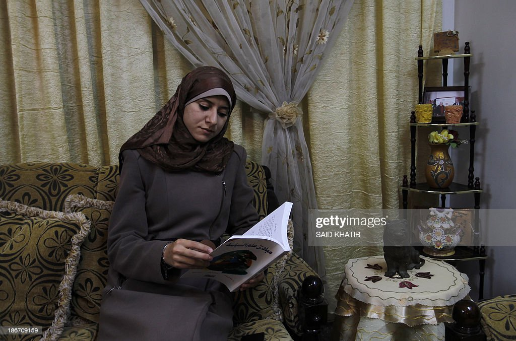 Isra Almodallal, the first woman to be nominated as spokeswoman for Gaza's Islamist rulers Hamas, sits in the livingroom of her home in the town of Rafah, in the southern Gaza Strip, on November 3, 2013. Almodallal, a 23-year-old journalist, told AFP last week her goal was 'to change the image of Palestinians and that of the government in Gaza,'.