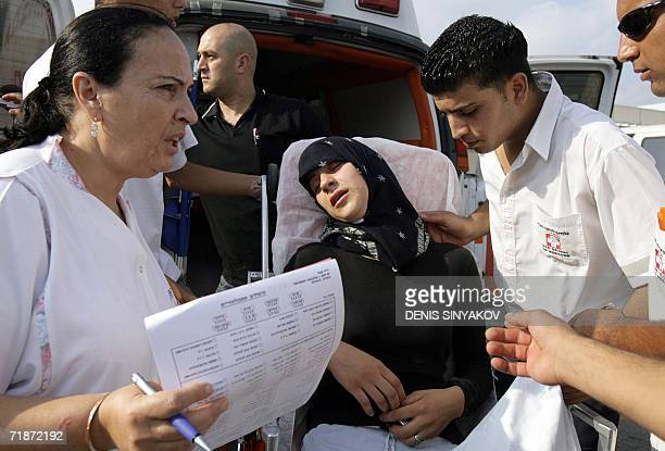 A Muslim woman in shock arrive at the hospital in the costal town of Nahariya 27 July 2006 after the ArabIsraeli village of Der Assad was hit by a...
