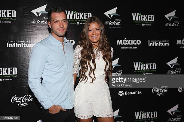 Israel Amescua and Vanessa Claudio attend the 'Wicked' red carpet at Teatro Telmex on October 17 2013 in Mexico City Mexico