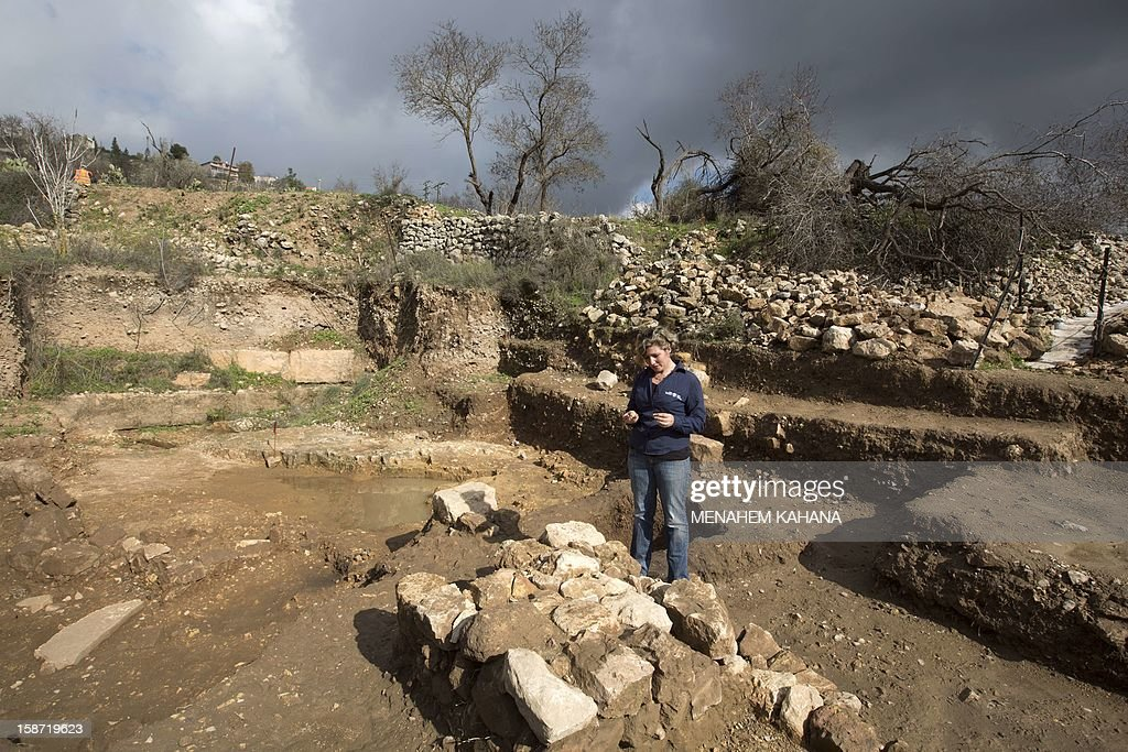 Israel Antiquities Authority archaeologist Anna Ririkh displays on December 26 2012 the temple site and the altar used for religious rituals and practices, dated to the early monarchic period (9-10th century. BC) of the Judaean monarchy, uncovered in Tel Motza near Jerusalem during rescue excavations. The findings include ritual pottery vessels, fragments of chalices and figurines of animals. AFP PHOTO/MENAHEM KAHANA