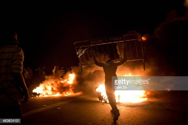 Israel Bedouins burn a Israeli police barricade during a protest against the Israeli government's Prawer Plan on road 31 on November 30 2013 near...