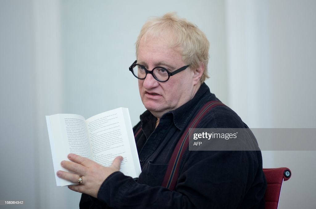 Israel born writer Tuvia Tenenbom addresses a press conference in Berlin on December 14, 2012. AFP PHOTO / JOHANNES EISELE