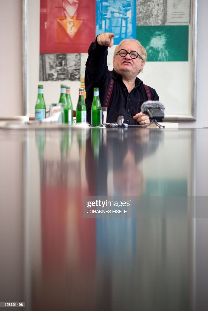 Israel born writer Tuvia Tenenbom gestures during a press conference in Berlin on December 14, 2012.