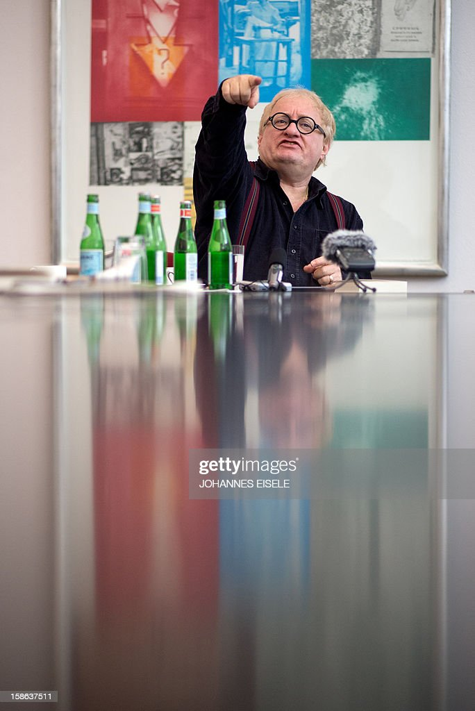 STORY - FILES - Israel born writer Tuvia Tenenbom gestures during a press conference in Berlin on December 14, 2012. AFP PHOTO / JOHANNES EISELE