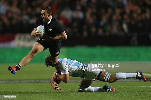 Israel Dagg is tackled during the Rugby Championship between the New Zealand All Blacks and Argentina at Waikato Stadium on September 7 2013 in...