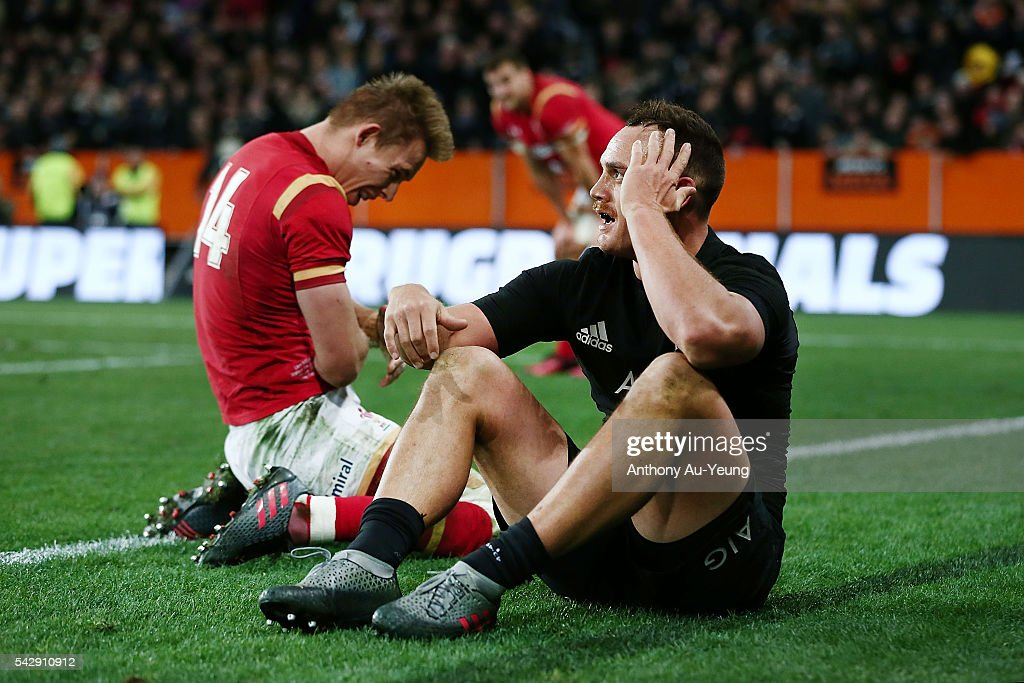 <a gi-track='captionPersonalityLinkClicked' href=/galleries/search?phrase=Israel+Dagg&family=editorial&specificpeople=2086281 ng-click='$event.stopPropagation()'>Israel Dagg</a> of New Zealand and <a gi-track='captionPersonalityLinkClicked' href=/galleries/search?phrase=Liam+Williams+-+Rugby+Union+Player&family=editorial&specificpeople=7852399 ng-click='$event.stopPropagation()'>Liam Williams</a> of Wales react after a clashes near the touchline during the International Test match between the New Zealand All Blacks and Wales at Forsyth Barr Stadium on June 25, 2016 in Dunedin, New Zealand.