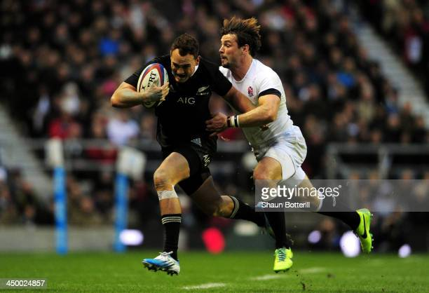 Israel Dagg of New Zealand breaks away from Ben Foden of England during the QBE International match between England and New Zealand at Twickenham...