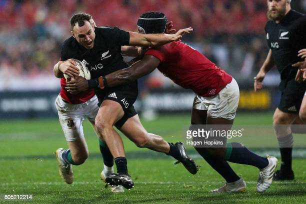 Israel Dagg of New Zealand is tackled by Liam Williams and Maro Itoje of the Lions during the International Test match between the New Zealand All...