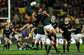 Israel Dagg of the All Blacks and Jan Serfontein of the Springboks compete for a high ball during The Rugby Championship match between the New...