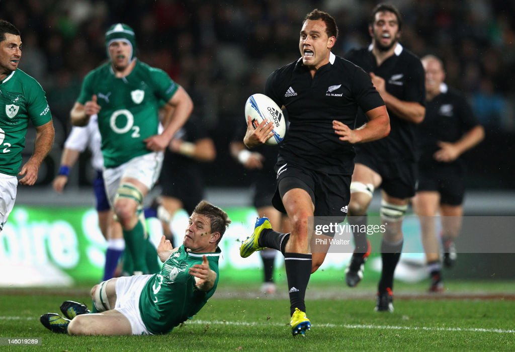 <a gi-track='captionPersonalityLinkClicked' href=/galleries/search?phrase=Israel+Dagg&family=editorial&specificpeople=2086281 ng-click='$event.stopPropagation()'>Israel Dagg</a> of the All Blacks breaks through the tackle of <a gi-track='captionPersonalityLinkClicked' href=/galleries/search?phrase=Brian+O%27Driscoll&family=editorial&specificpeople=194745 ng-click='$event.stopPropagation()'>Brian O'Driscoll</a> of Ireland during the International Test Match between the New Zealand All Blacks and Ireland at Eden Park on June 9, 2012 in Auckland, New Zealand.
